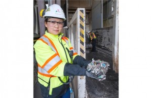 Stephanie Voysey, B.C. environment and public affairs co-ordinator for Lafarge, with non-recyclable plastics that will be used to fuel the kiln at the Lafarge Cement facility in Richmond that is used in the cement-making process. Photograph by: Jenelle Schneider, SUN